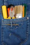 Hulpmiddelen en instrumenten in jeans Stock Fotografie