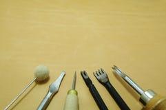 Hulpmiddelen op het leer Stock Foto