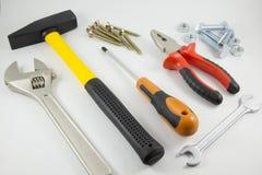 Hulpmiddelen voor bouw en reparatie op een witte achtergrond Stock Afbeeldingen