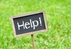 Hulpteken op een bord Stock Afbeelding