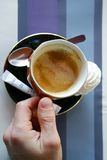 Hum...coffee. Cup of coffee with spoon and sugar on a lined tablecloth Royalty Free Stock Photos