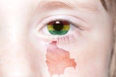 Human& x27; 与玻利维亚的国旗和地图的s面孔 免版税库存图片