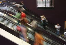 Human Activiy. Movement Capture using slow shutter on Escalator in a big city Stock Images
