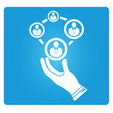 Human allocation. Hand holding group of people on blue background Stock Photos
