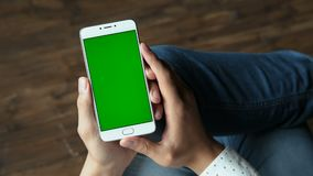 Man using phone with green screen hold in hands. Human arms hold electronics portable device with greenscreen chromakey closeup. Guy gesturing: tapping app by stock video