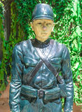 Human army statue. Asia style on green grass backgrounds at public park royalty free stock photography