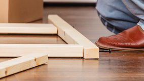 Human assembling wood furniture. DIY. Stock Images