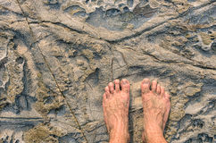 Human barefeet on a Stone background Stock Images