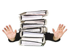 Human behind a stack of Ring Binders Royalty Free Stock Image
