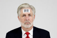 Human Being With Bar Code. A businessman with a barcode on his head showing how he thinks his employer sees him Stock Photos