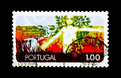 Human Being and Nature, Protection of Nature serie, circa 1971. MOSCOW, RUSSIA - NOVEMBER 24, 2017: A stamp printed in Portugal shows Human Being and Nature Stock Image