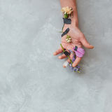 Human being`s hand with flowers Royalty Free Stock Images