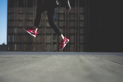 Human in Black Track Pants With Red Nike Sneakers Jumping Royalty Free Stock Images
