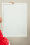 Human with blank empty white banner. Advertisement Stock Photo