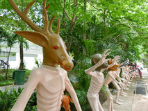 Human body with deer and other animal head statue Royalty Free Stock Photo