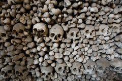 Human bones and skulls. In ossuary closeup Stock Image