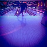 Man bowling under black light Stock Images