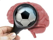 Human Brain Analyzed with magnifying glass Soccer ball or football ball addiction inside isolated. On white stock illustration