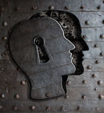 Human brain door with keyhole concept made from metal gears. And cogs Royalty Free Stock Images