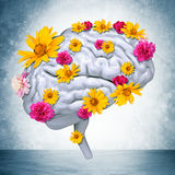 Human brain with flowers. On grey wall background. 3D rendering stock photos