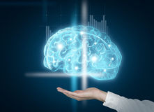 Human brain. Hand as if holding image of brain shining blue. Concept of mental activity Stock Photo