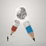 Human brain inside pencil light bulb. Businessman looking at 3d metal human brain inside pencil light bulb  as concept Royalty Free Stock Photo
