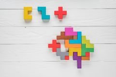 Human brain is made of wooden blocks. Creative medical or business concept. Logical tasks. Conundrum find the missin. Human brain is made of multi-colored wooden Royalty Free Stock Photography