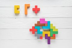 Human brain is made of wooden blocks. Creative medical or business concept. Logical tasks. Conundrum find the missin. Human brain is made of multi-colored wooden Stock Photo