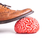 Human brain under a business man feet Stock Photos