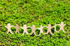 Human Chain On Green Plant Royalty Free Stock Photography