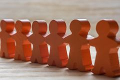 Human chain of wooden figures as a sign of peace and cohesion royalty free stock images