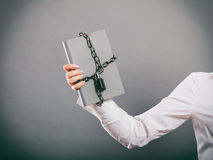 Human with chained document file. Stock Photography