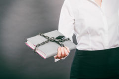 Human with chained document file. Stock Photos