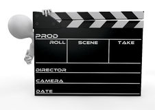 Human character appearing from behind a clapperboard Stock Image