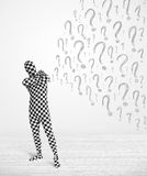 Human character is body suit looking at hand drawn question m Stock Image