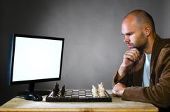 Human chess player against computer Stock Images