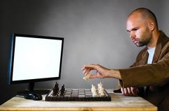 Human chess player against computer Royalty Free Stock Image