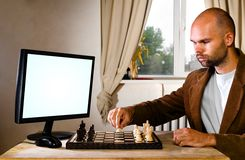 Human chess player against computer Stock Photography