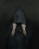 Human in coat with a hood Royalty Free Stock Images