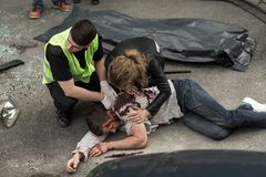 Human corpse on the street. Corpse of young men lying on the street Stock Photos