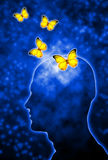 Human creativity. Human head shape with butterflies flying out of the head Royalty Free Stock Photos