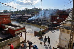 Human cremation ghtas along the holy Bagmati river. Pashupatinat Royalty Free Stock Photography