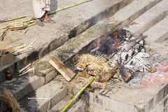 Human Cremation at Pashupatinath Temple, Nepal. Image of open human cremation being carried out at Unesco's 5th century World Heritage site of Pashupatinath stock photography