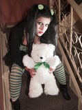 Human doll with a stuffed bear on stairs Stock Photography