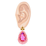 Human ear & hanging earring Stock Photos