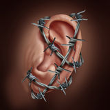 Human Ear Pain. And earache infection symbol as barbed wire wrapped around the hearing body part causing a sharp burning disease as otitis or swimmers ear ache Royalty Free Stock Photo