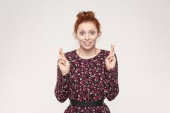 Human emotions and feelings. Superstitious teenager ginger woman stock photo