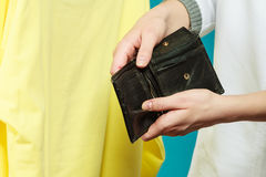 Human with empty wallet purse. Lack of money. Royalty Free Stock Images
