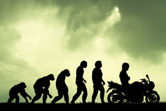 Human evolution with motorcycle Stock Photo