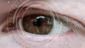 Human eye and abstract hi-tech circle. Macro eye and VR surveillance system. Male eye with abstract hi-tech circle element. Human being futuristic vision stock video